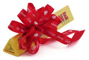 personalized ribbon tied around a chocolate treat for corporate gifting