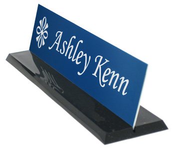 Black plastic desk base with a blue name plate.