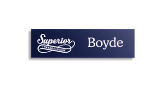 A dark blue name tag is engraved with a white logo and text.