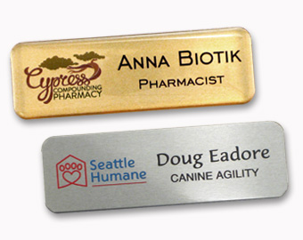 Two metal name tags with UV color logos.