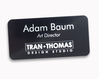 Metal name tags with laser engraved logos, 1.5x3 inches
