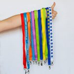 finding new ways to wear custom lanyards while camping and participating in summer activities