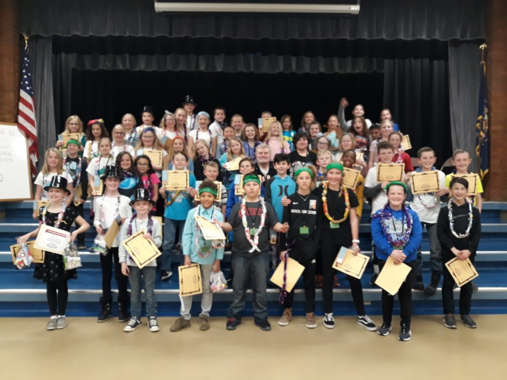 Students at Grant Elementary wearing lanyards for the Battle of the Book competition.