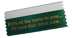 A green badge ribbons customized with a movie quote, used to create a fun work culture.