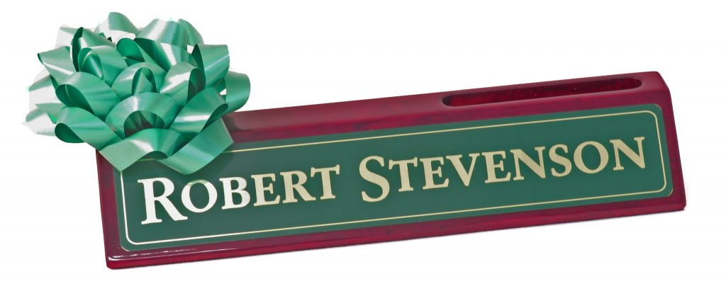 An executive desk wedge with a green bow on top, one of the right corporate gifts to give this year.