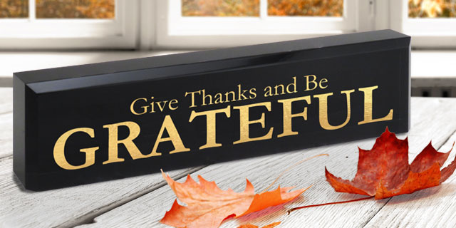 Black Acrylic Desk Block (Text Only) with an engraved gold colored holiday message.