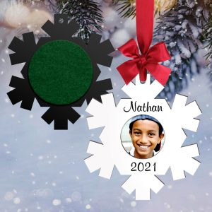 Snowflake shaped name tag used as a holiday ornament that will hold a picture.
